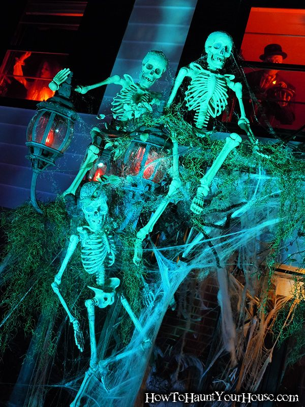 in the upstairs windows add figures and lights that could be seen from the road - Halloween Outdoor Lights