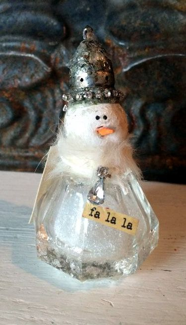 This cute little snowman has been hand sculpted and placed on a vintage crystal Salt shaker.