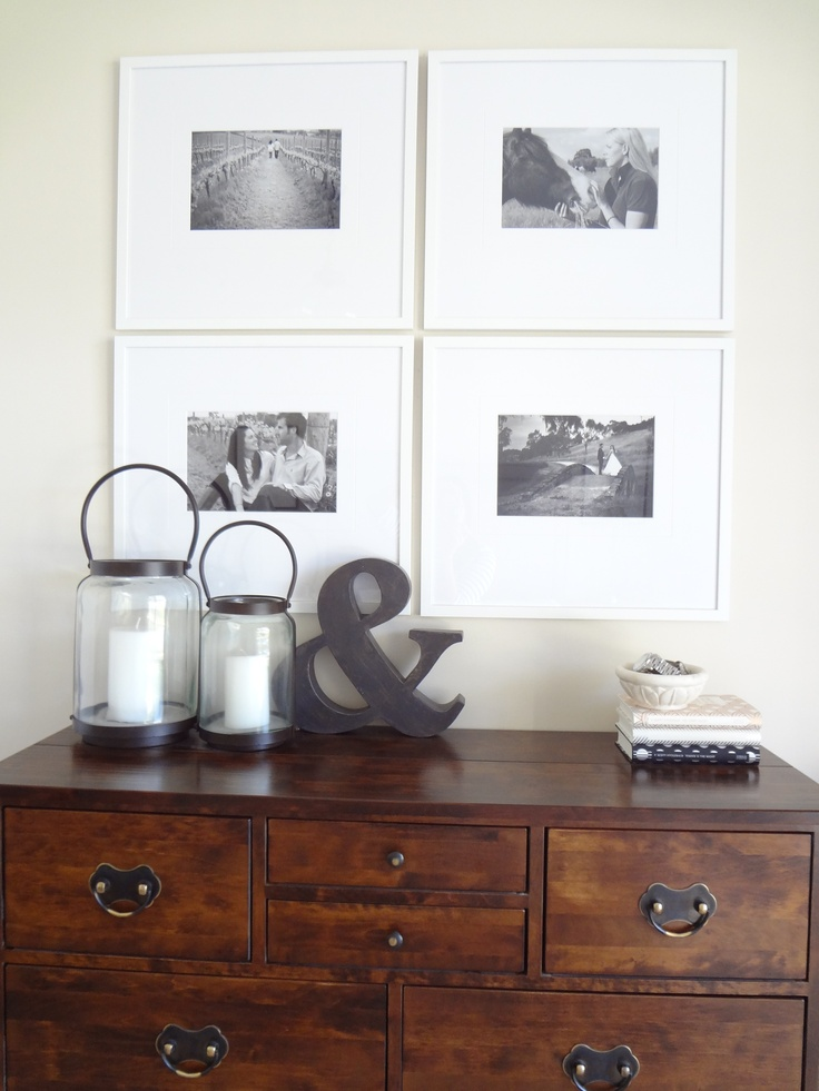Chest of drawers with black and white photographs