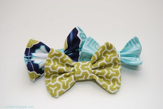 Cute little fabric bows. Pretty easy to make. I attached mine to a elastic for a baby headband.