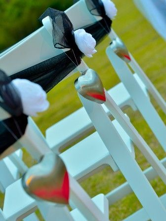 Eternal Weddings Décor and Photography. Contemporary Wedding. Elegant Wedding Decorations. Love Hearts. White Americana Chairs. Black Chair Sash. White Flower Decorations.