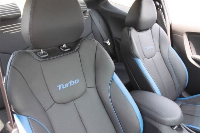 """2013 Hyundai Veloster Turbo Blue Interior.  The blue highlights and unique Turbo badging make the Veloster Turbo's interior """"pop"""" and stand out.  Looks great with the Ironman Silver exterior. Check out the new Veloster Turbo at Napleton's Valley Hyundai in Aurora today."""