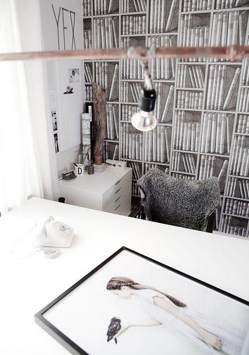 Fornasetti bookcase wallpaper.
