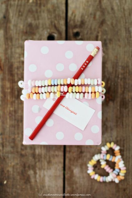 ❥ cute gift packaging idea...using candy necklaces instead of ribbon