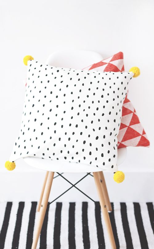 DIY cushion - I like the black and white polka dot with the yellow pom poms!
