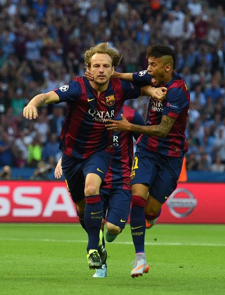 Ivan Rakitic of Barcelona celebrates scoring the opening goal with Neymar (R) during the UEFA Champions League Final between Juventus and FC Barcelona at Olympiastadion on June 6, 2015 in Berlin, Germany.