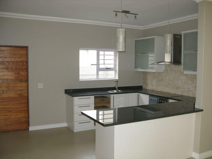 Modern open plan kitchen with granite tops