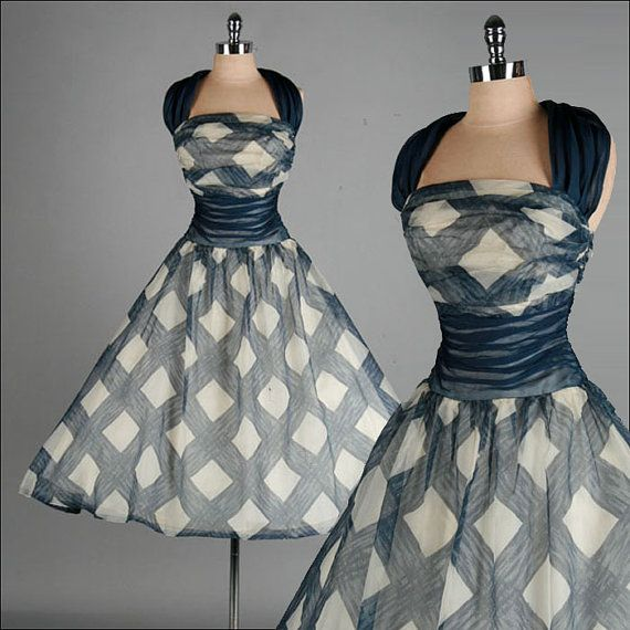 Vintage dress from the 1950s. Materials: metal zipper, chiffon, organza. Blue and Ivory.
