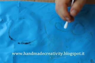 handmade drawing board with paint inside a plastic bag.    lavagna fatta in casa con tempere dentro una busta di plastica
