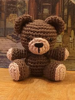 "This is a free crochet pattern for a small, sitting teddy bear. This teddy is made using the same basic body structure as my free Sunny Bunny pattern. He measures approximately 3.75"" tall and was made using Sugar n' Cream cotton yarn and a 3mm hook. You can use any yarn and hook desired, it will only change the size of your finished teddy."