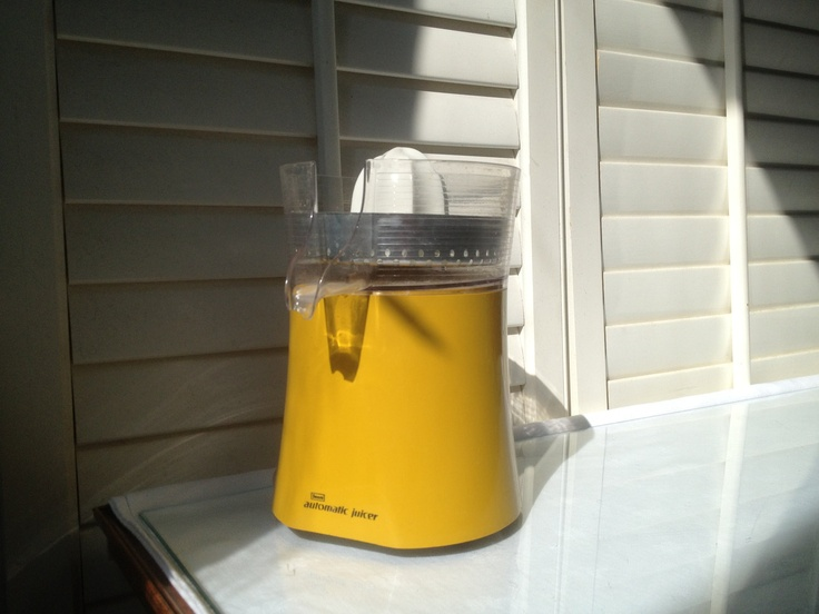 Retro Yellow Juicer - Sears Roebuck and Company Automatic Juicer - Vintage, Atomic, Mid-century style. $18.00, via Etsy.