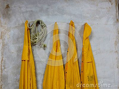 Four yellow rain coats and a rope