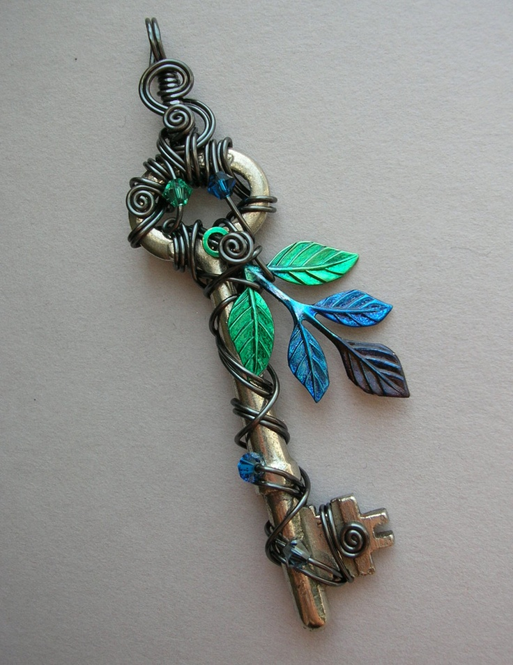 Hematite Wire Wrapped Key Pendant with Green/Blue Leaves-- hand inked leaf sprig, hematite wire, Swarovski crystals. $56.00, via Etsy.