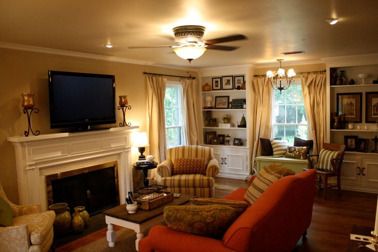 Awesome Ceiling Fan With Light Also Red Sofa Design Plus Double Sided Fireplace In Cozy Country Living Room Idea