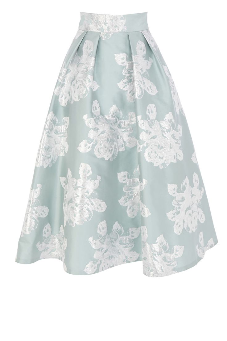 A show-stopping catwalk inspired midi skirt with statement volume. The Rita skirt features subtle pleats at the waist that create a modern look whilst a tulle under skirt creates exaggerated fullness and dramatic flaring. Oozing vintage appeal, the skirt is adorned in metallic floral embroidery making for the perfect finishing touch. Fully lined this skirt is fitted with an invisible back zip fastening. Skirt length from waist to hem is 35.5 inches/90 cm. To the complete the look, wear with…