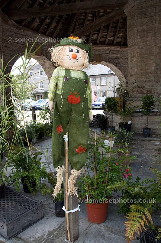 Scarecrow in the Market Cross - Somerton somerset england pictures photos photographs