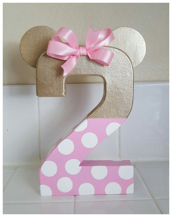 Minnie mouse inspired number photo prop and birthday decoration. Made with an 8 paper mache number handpainted light pink and gold. Custom orders are welcome. Please contact me with any questions. Letters are also available for initials or full names. I also make Minnie in light pink, hot pink or red with black please visit my shop for other options. Numbers are 8 inches tall and the ears add an additional inch.