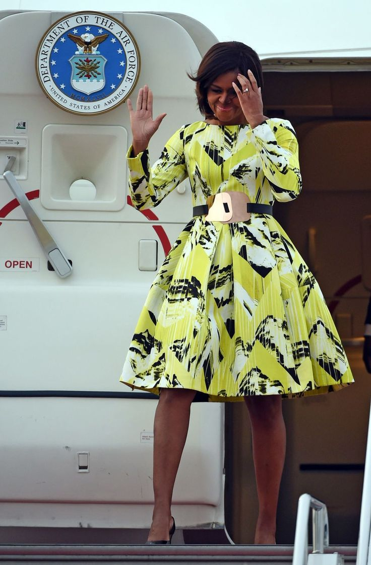 In Kenzo. See all the First Lady's colorful Cambodia-Japan tour looks. (There's a crop top in the mix!)