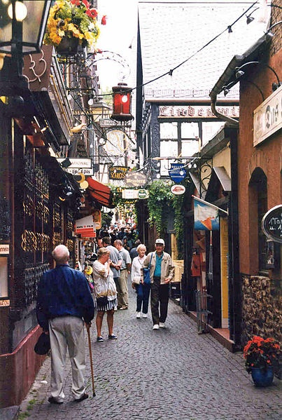 Charming cobblestone street full of live entertainment, shopping, taverns, and restaurants. One of the featured stops on a Rhine river cruise. Rüdesheim Drosselganger.jpg