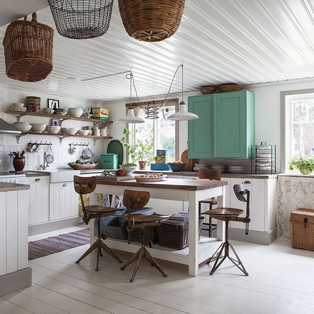 Love this kitchen with the open shelves, unique wall hooks and pop of turquoise.
