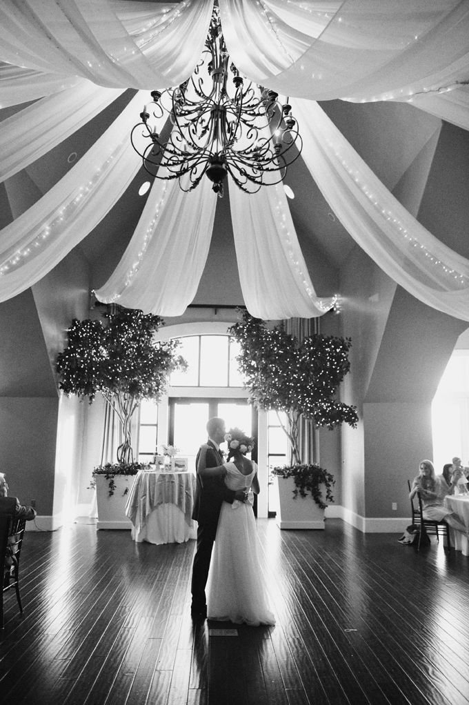 Black and White wedding picture of the bride and groom performing their wedding dance in our beautiful Sunset Room!