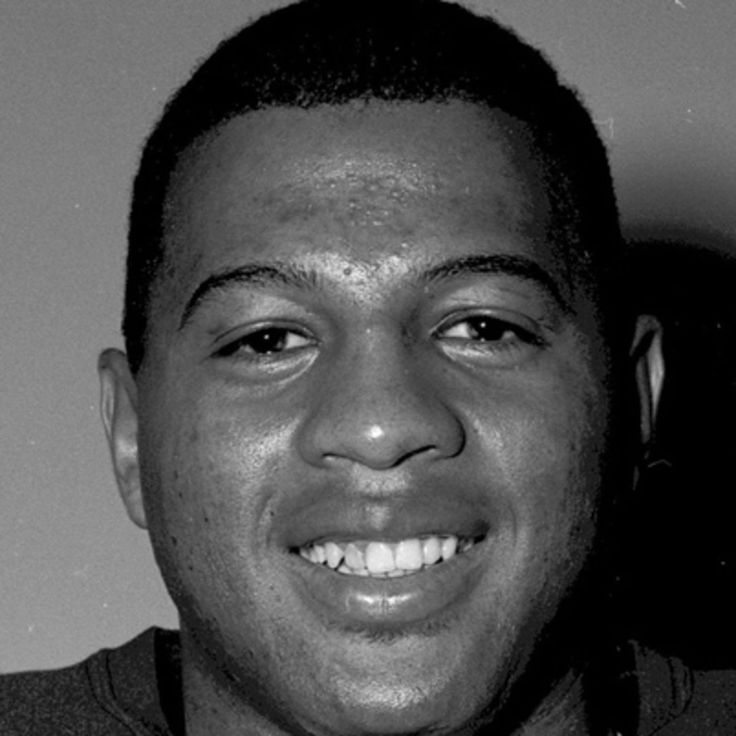 Remember Ernie Davis, the first African-American to win the Heisman Trophy before his life was tragically cut short by leukemia, on Biography.com.