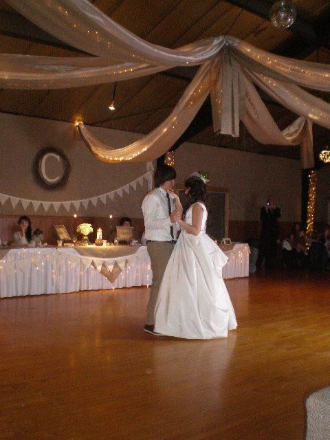 The hanging centerpiece was lighted organza with swathes of burlap underneath.