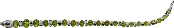 CARTIER. Bracelet - white gold, melon-cut peridots, orange sapphires, onyx, emerald eyes, brilliant-cut diamonds. #Cartier #CartierMagicien #HauteJoaillerie #FineJewelry #Peridot #OrangeSapphire #Emerald #Onyx #Diamond