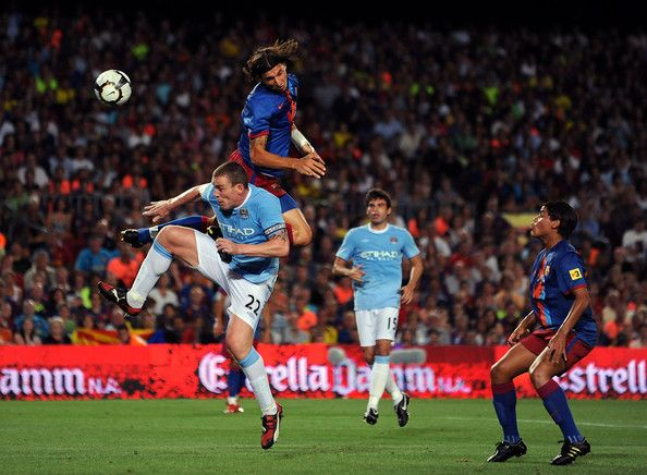 Zlatan Ibrahimovic Photos Photos - Zlatan Ibrahimovic (2L) of Barcelona duels in the air with Richard Dunne of Manchester City during the Joan Gamper Trophy match between Barcelona and Manchester City at the Camp Nou Stadium on August 19, 2009 in Barcelona, Spain. Manchester City won the match 1-0. - Barcelona V Manchester City - Joan Gamp Trophy