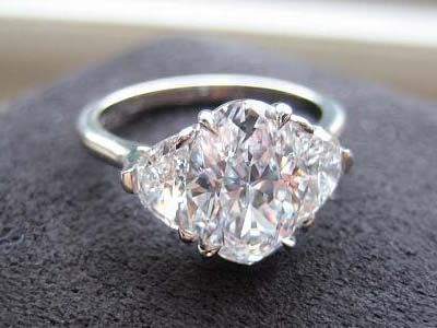 A three stone, oval cut white diamond engagement ring.. I'm not getting any younger here.. Hi, Love! :))