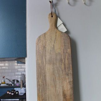This gorgeously large cutting board is handmade from sustainable mango wood. The natural grain of the wood and smooth finish makes it incredibly tactile and heavenly to use. It's a fantastic size with plenty of chopping space and will make a great gift for anyone who enjoys cooking and preparing food. It can also be used as an elegant way to serve breads or antipasti. Made from sustainable mango wood its both stylish and eco friendly. £34.95