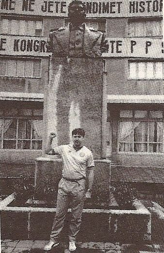 An appropriately grainy black and white image of Rory O'Callaghan in the old crushed canary green away strip standing in front of a statue of the Russian left-winger Josef Stalin. If you're wondering where such statues were still standing in the 90s the answer is the glorious workers paradise of Albania (a place called Korce to be exact).