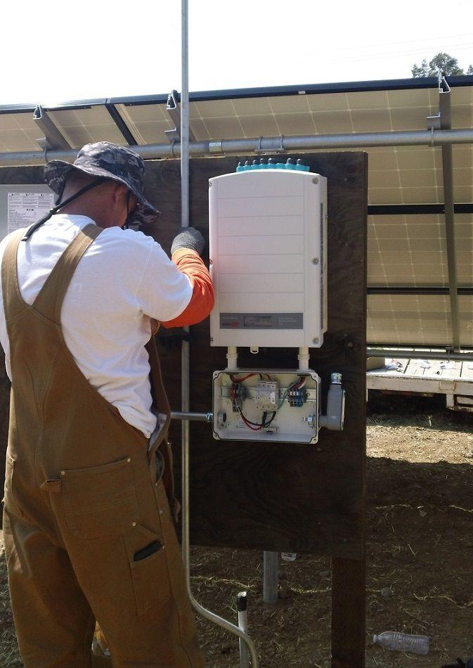 Working on the Solar panels electronics ( Vacaville California HVAC Solano Napa Fairfield Benicia Vallejo Suisun Green Energy )