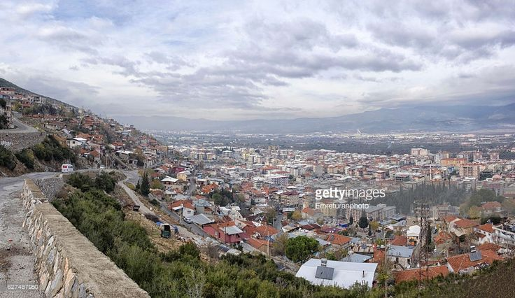 Mount Nif is situated just above Kemalpasa town in Izmir province in Aegean Turkey.Seen here is a panoramic view of the town taken from a relatively low elevation in mount Nif on a cloudy winter day.