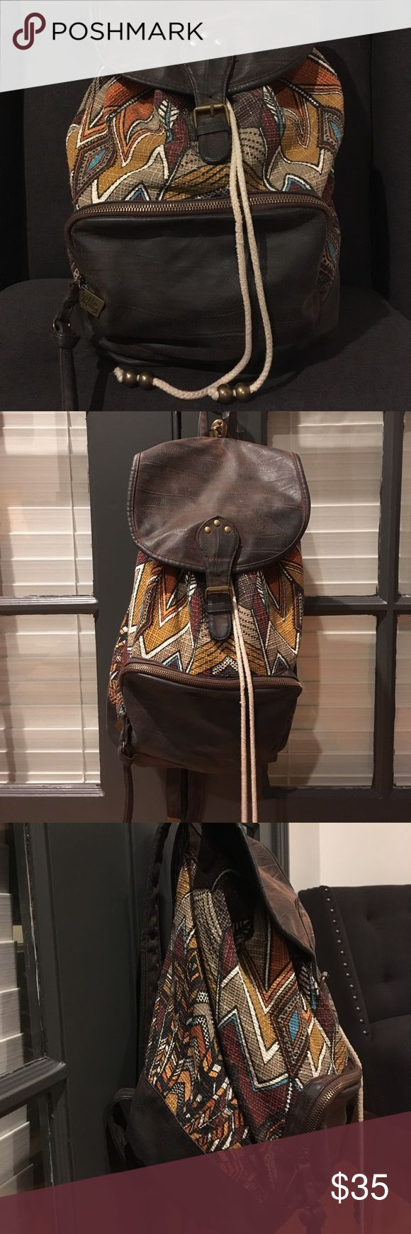 Billabong Oracle Fox Backpack Ethnic pattern with faux leather trim. Has a small zip pocket on front and one zip pocket inside. Magnetic snap buckle with drawstring tie. Straps adjust. Very clean inside and out, in great condition! This backpack is out of stock in stores. Billabong Bags Backpacks