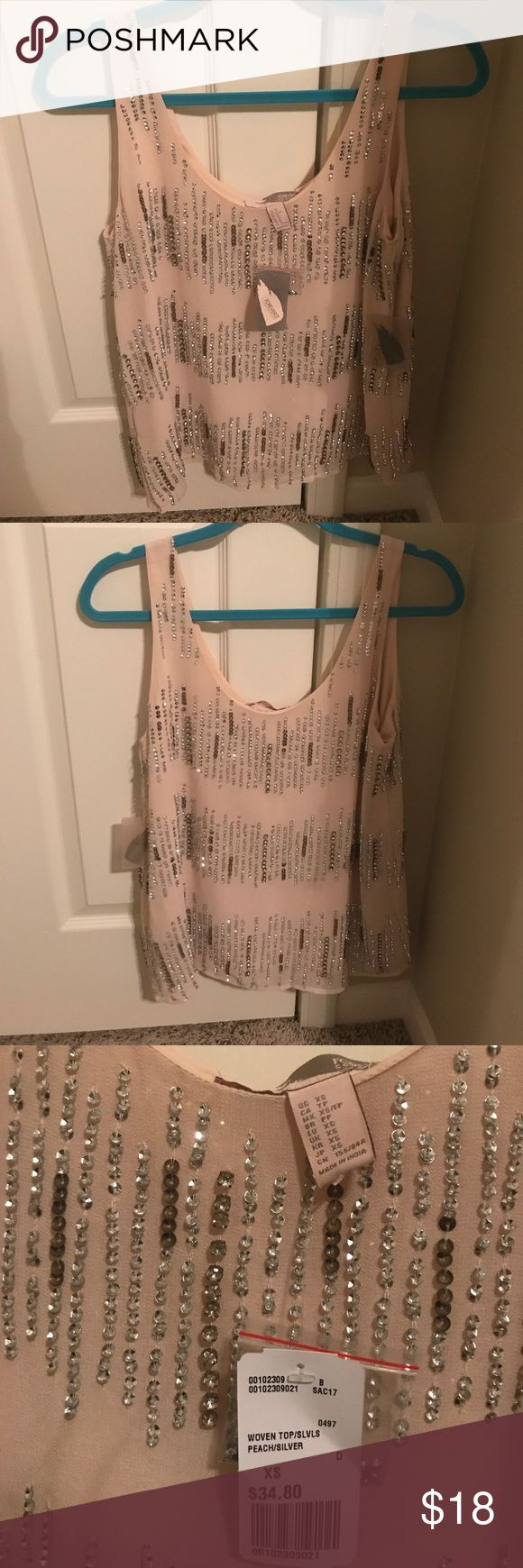 Sequence tank top NWT! Sequence and beaded flowy sleeveless blouse. Solid slip built in so no peek through. Includes extra beading pack with tags. Super cute with white denim. Tops Tank Tops