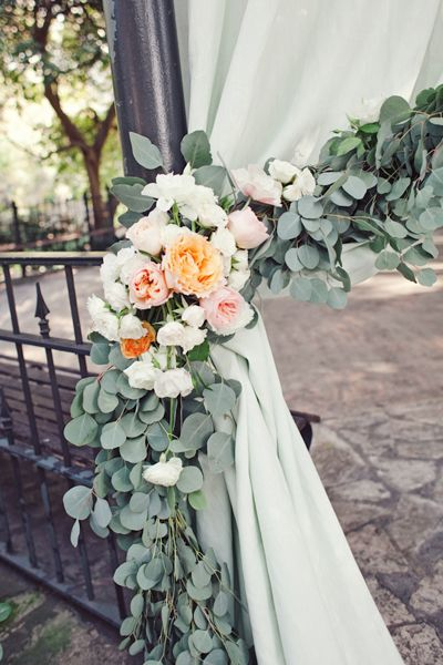 floral swags tying back the ceremony curtains | The Nichols #wedding