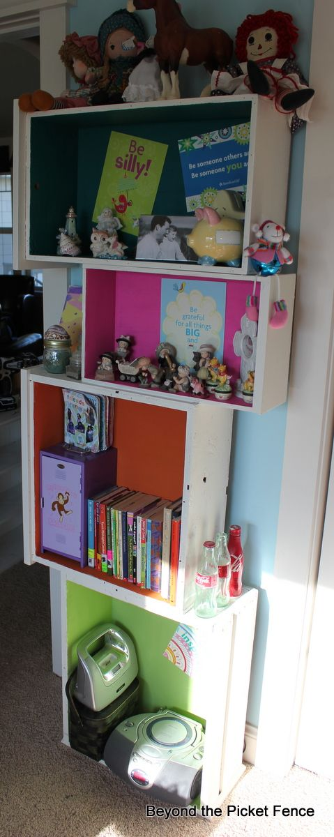 Repurposing old drawers as shelving.  What a great idea for a kids' room, rumpus room or office!
