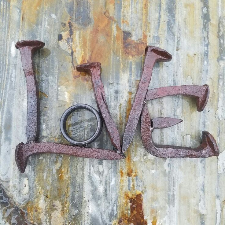 Railroad spike art, love word art, railroad spike word, love wall hanging, love shelf art, metal art, weld art, rustic wedding decor, hand forged railroad spikes, scrap metal art