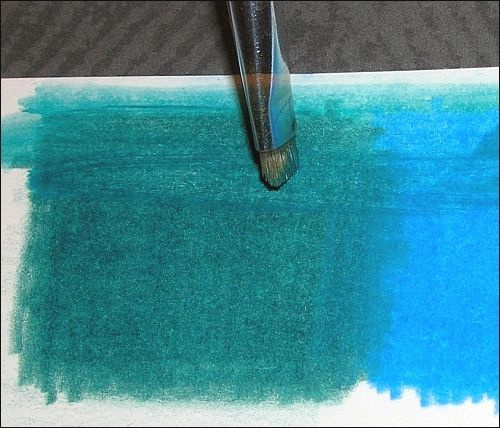 "Blending--bristle brush and a ""scrubbing motion"" to get down through multiple layers of colored pencil."