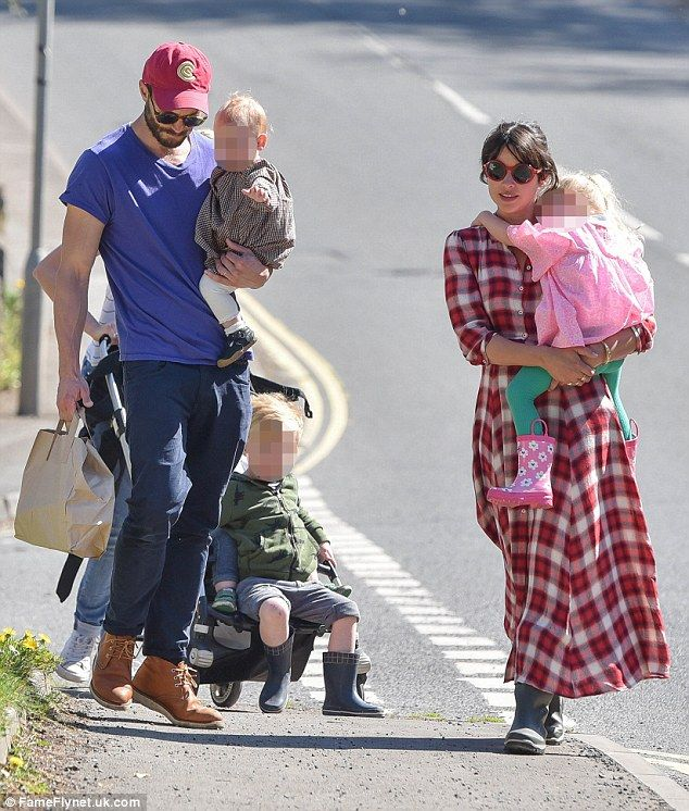Happier than ever:Jamie Dornan and his wife Amelia Warner looked like the perfect family unit as they headed out for a stroll in the sun during an outing in their resident Gloucestershire over the weekend