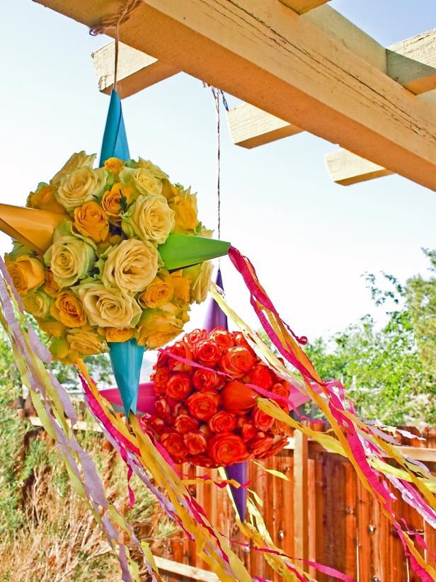 A luxurious and fragrant update to the traditional piñata, the sophisticated color palette and whimsical flare of this party decor will be the star at your next fiesta.