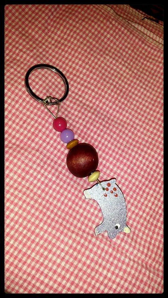 Hand painted wood piggy beaded with an assortment of beads and strung on copper wire with a key ring ooak