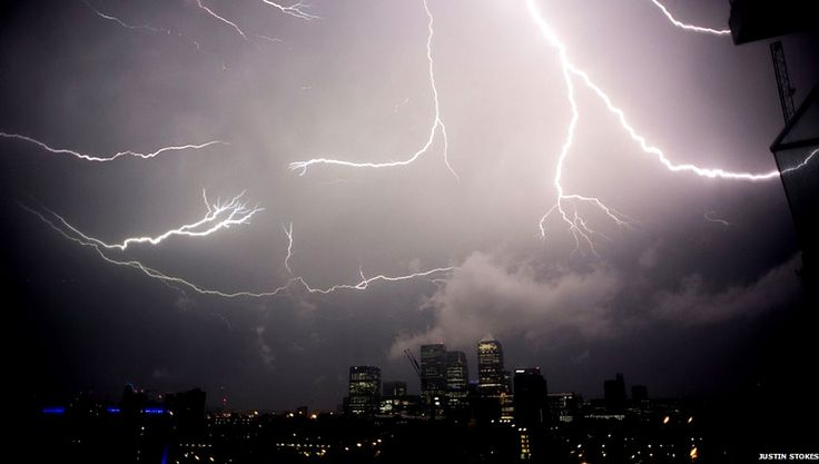 London, Canary Wharf, early morning of Friday 18 July 2014  A sensational display of Summer thunder and lightning bolts hit much of UK early this morning, as a consequence of the very hot day (yesterday temperatures reached 30 degrees). London too experienced a quite impressive show, as in this photo taken in Canary Wharf (photo by Justin Stokes, via BBC News)