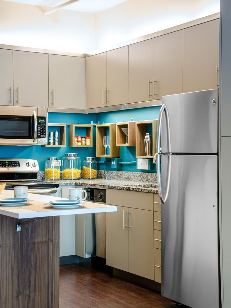 custom made kitchen island and storage boxes with a teal green chalkboard painted backsplash