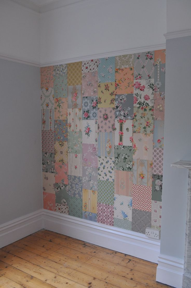 A patchwork quilt effect using vintage wallpaper cuttings on a wall.