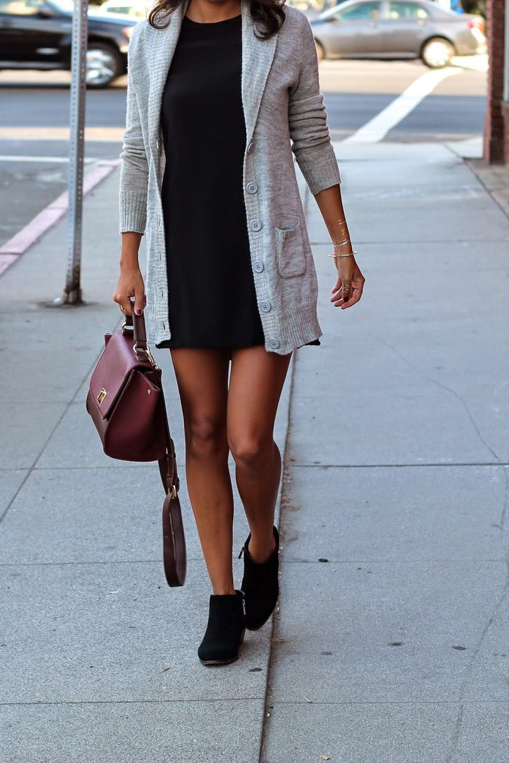 Ashley Torres is wearing a black dress from Naven, grey cardigan from Banana Republic, bag from Sole Society and the boots are from DSW