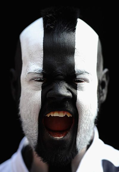 Newcastle Upon Tyne, England: A Newcastle United fan shows his support