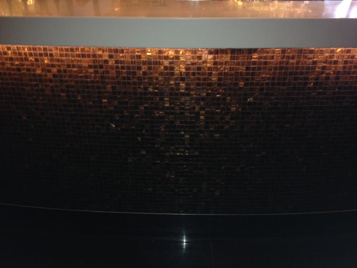 PHOTO 18 Velvet Bar: The amber mosaic tiles lining the bar are perfectly lit, creating a warm glow.