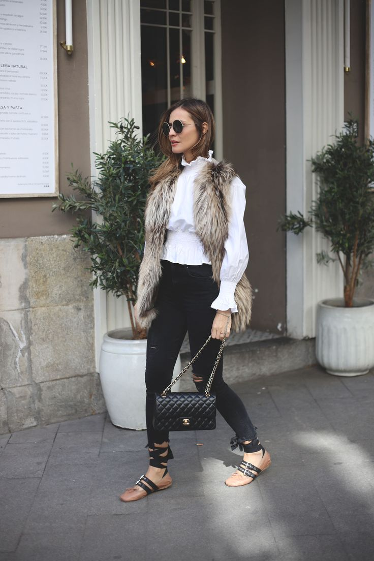 look of the day looks - Lady Addict. White romantic blouse+blck cropped skinny jeans+blush lace-up ballerinas+beige fur vest+sunglasses. Winter To Spring Transition Casual Outfit 2017